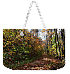 Weekender Tote Bag featuring the photograph Autumn Woods Road by Rick Morgan