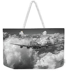 Weekender Tote Bag featuring the photograph Avro Lancaster Above Clouds Bw Version by Gary Eason