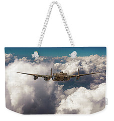 Weekender Tote Bag featuring the photograph Avro Lancaster Above Clouds by Gary Eason