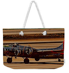 Weekender Tote Bag featuring the photograph B-17 Bomber by Dart Humeston