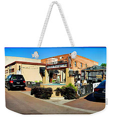 Back Alley View Of The Gaslight Inn Patio Weekender Tote Bag by Charles Ables