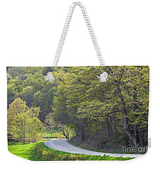 Weekender Tote Bag featuring the photograph Back Road Spring by Alan L Graham