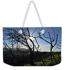 Weekender Tote Bag featuring the photograph Backlit Trees Overlooking Hillside by Matt Harang