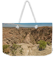 Weekender Tote Bag featuring the photograph Badlands National Park by Brenda Jacobs
