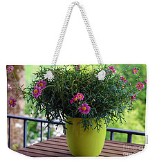 Weekender Tote Bag featuring the photograph Balcony Flowers by Susanne Van Hulst