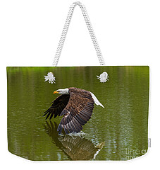 Bald Eagle In Low Flight Over A Lake Weekender Tote Bag