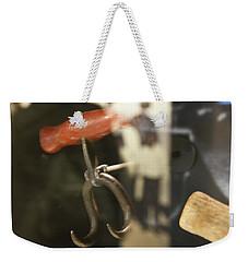 Weekender Tote Bag featuring the photograph Bale Hooks by Miroslava Jurcik