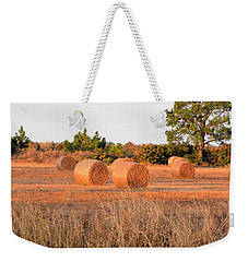 Weekender Tote Bag featuring the photograph Bales by Rosalie Scanlon