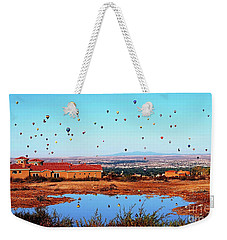 Weekender Tote Bag featuring the photograph Balloon Reflections by Gina Savage