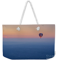 Weekender Tote Bag featuring the photograph Ballooning In The Haze by Ray Warren