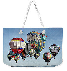 Weekender Tote Bag featuring the photograph Ballooning by Marie Leslie