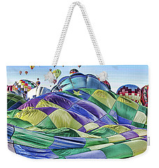 Weekender Tote Bag featuring the photograph Ballooning Waves by Marie Leslie