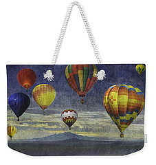 Weekender Tote Bag featuring the photograph Balloons Over Sister Mountains by Melinda Ledsome
