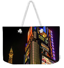 Weekender Tote Bag featuring the photograph Ballys Sign In Front Of The Eiffel Tower At Night by Aloha Art