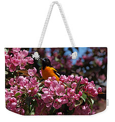 Weekender Tote Bag featuring the photograph Baltimore Oriole by Susan Dimitrakopoulos
