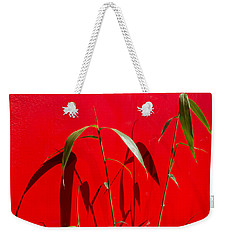 Bamboo Against Red Wall Weekender Tote Bag
