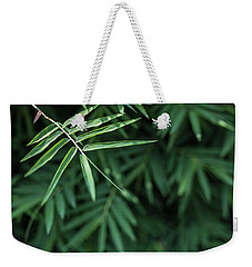 Weekender Tote Bag featuring the photograph Bamboo Leaves Background by Jingjits Photography