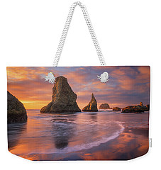 Weekender Tote Bag featuring the photograph Bandon's New Years Eve Light Show by Darren White
