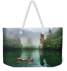 Weekender Tote Bag featuring the photograph Baofeng by Wade Aiken