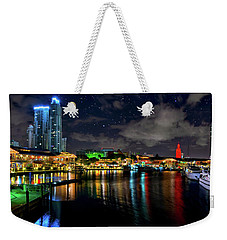 Weekender Tote Bag featuring the photograph Bayside Miami Florida At Night Under The Stars by Justin Kelefas