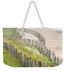 Weekender Tote Bag featuring the photograph Beach Fences In A Storm by Betty Denise