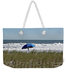 Weekender Tote Bag featuring the photograph Beach Umbrella by Denise Pohl