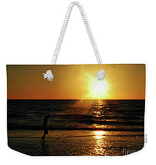 Weekender Tote Bag featuring the photograph Beach Walking by Gary Wonning