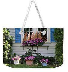 Weekender Tote Bag featuring the photograph Beautiful Ship Flower Boxes by Living Color Photography Lorraine Lynch
