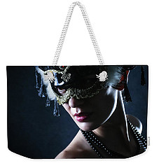 Weekender Tote Bag featuring the photograph Beauty Model Wearing Venetian Masquerade Carnival Mask by Dimitar Hristov