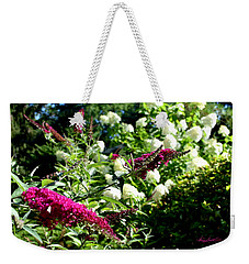 Weekender Tote Bag featuring the photograph Beckoning Butterfly Bush by Hanne Lore Koehler