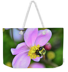 Weekender Tote Bag featuring the photograph Bee And Japanese Anemone by Kerri Farley