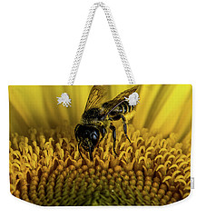 Weekender Tote Bag featuring the photograph Bee In A Sunflower by Paul Freidlund