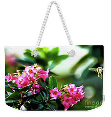 Weekender Tote Bag featuring the photograph Bee In Flight by Micah May