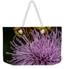 Weekender Tote Bag featuring the photograph Bee On A Thistle by Paul Freidlund