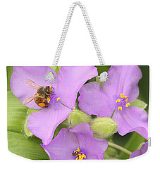 Weekender Tote Bag featuring the photograph Bee On Purple Spiderwort by Sheila Brown
