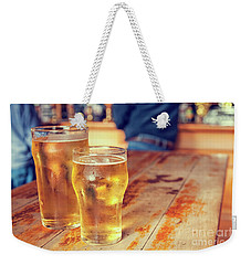 Weekender Tote Bag featuring the photograph Beers In A Pub by Patricia Hofmeester