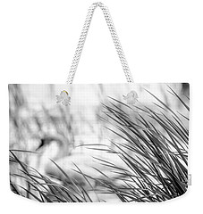 Weekender Tote Bag featuring the photograph Behind The Grass by Steven Santamour