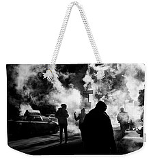 Weekender Tote Bag featuring the photograph Behind The Smoke by Johnny Lam
