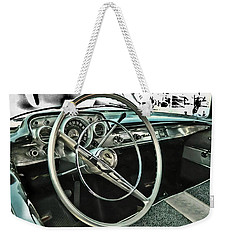 Weekender Tote Bag featuring the photograph Behind The Wheel by Victor Montgomery