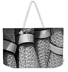 Weekender Tote Bag featuring the photograph Belts by David Pantuso