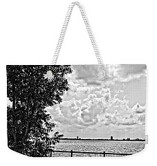 Weekender Tote Bag featuring the photograph Bench Overlooking The Bay by Maggy Marsh