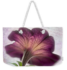 Weekender Tote Bag featuring the photograph Beneath A Dreamy Petunia by David and Carol Kelly