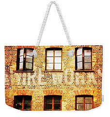 Weekender Tote Bag featuring the photograph Bermondsey Mesh And Wire Works by Anne Kotan