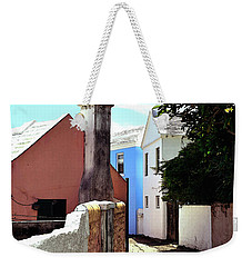 Weekender Tote Bag featuring the photograph Bermuda Backstreet by Richard Ortolano
