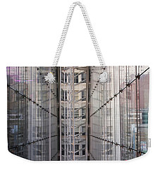 Weekender Tote Bag featuring the photograph Between Glass Walls by Rona Black