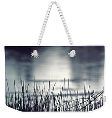 Weekender Tote Bag featuring the photograph Between The Waters by Trish Mistric