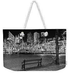 Weekender Tote Bag featuring the photograph Bicycle On The Plein At Night - The Hague  by Barry O Carroll