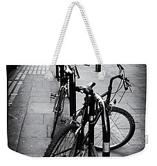 Bicycles In A London Street Weekender Tote Bag by Lynn Bolt