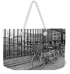 Weekender Tote Bag featuring the photograph Bicycles On Magdalene Bridge Cambridge In Black And White by Gill Billington