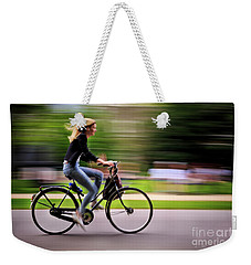 Weekender Tote Bag featuring the photograph Bicycling Woman by Craig J Satterlee